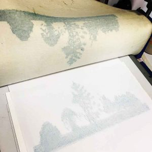 I ran cartridge paper through the press to blot the excess ink from the blanket