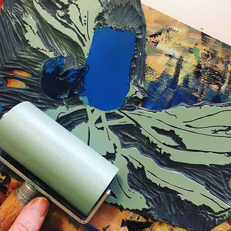 'Guzzling' reduction linocut print in progress