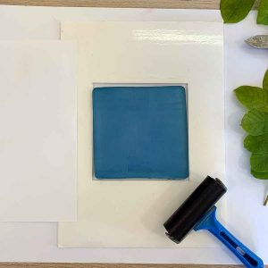Gel print with a white silhouette - step 1 - ink the plate
