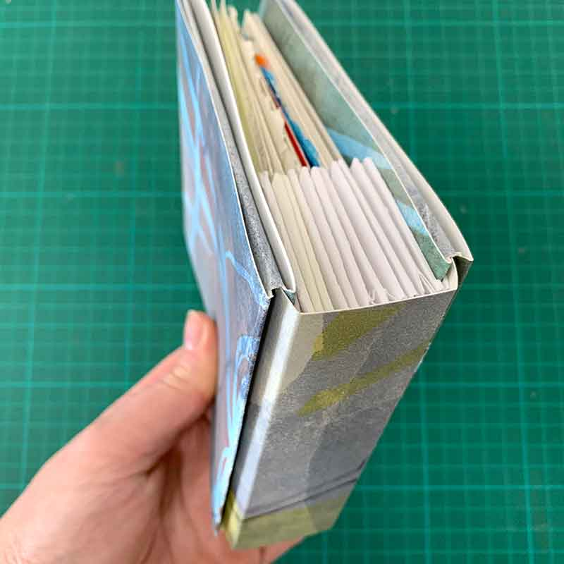 Slip covers with folded spine insert