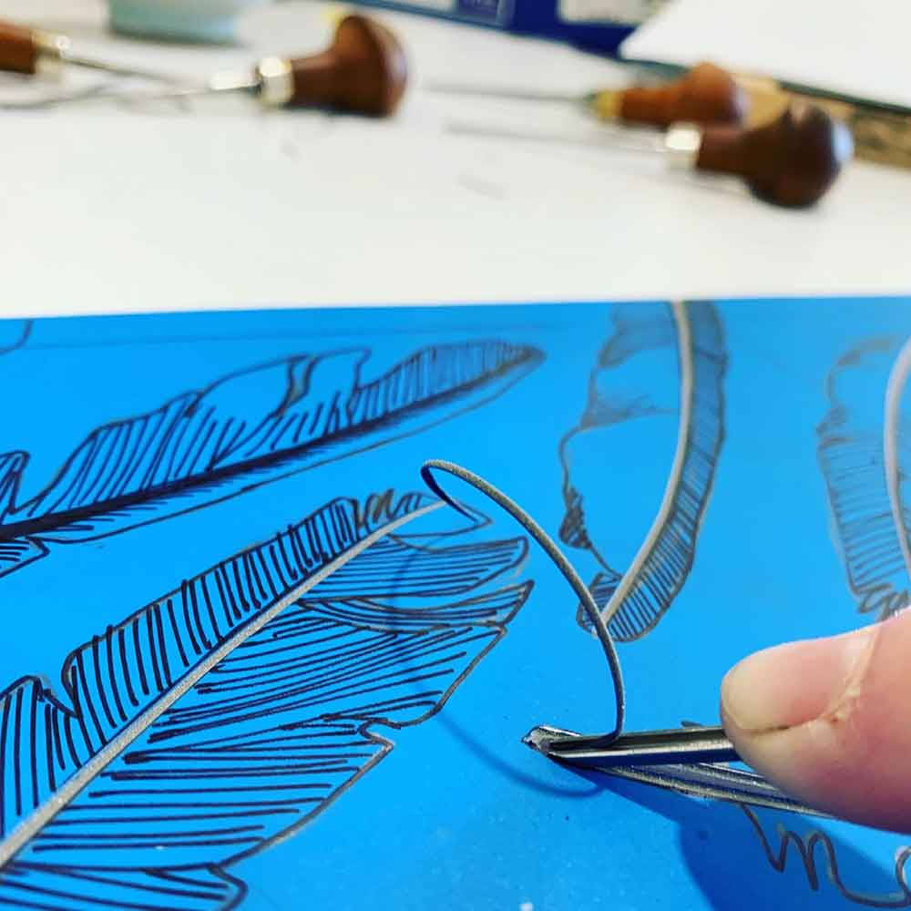 Magpie Stories - artist book embossing lino block carving